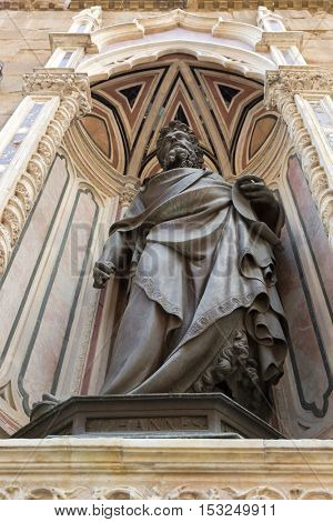 FLORENCE, ITALY - SEPTEMBER 2016 : Bronze statue of St. John the Baptist, detail of Orsanmichele church exterior with 1of 14 external niche figures in Florence, Italy on September 21, 2016.