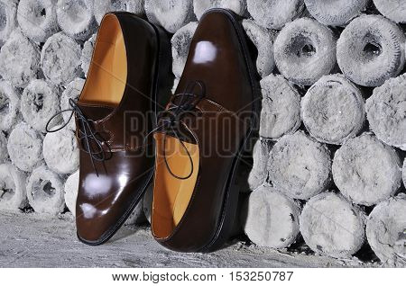 Pair of stylish handmade brown leather shoes with laces displayed conceptual of original design quality and craftsmanship