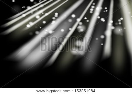 christmas multicolored rays of light bokeh isolated on black background