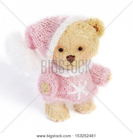 Teddy bear in classic vintage style isolated on white background
