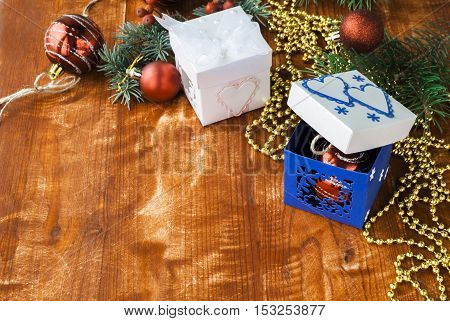 white and blue box with Christmas toys on a wooden table