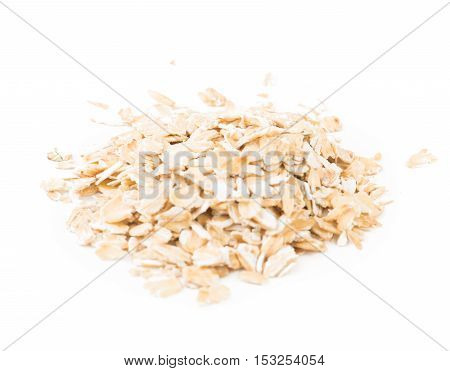 Bunch of oat flakes isolated on white background.