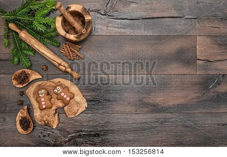 Christmas gingerbread man cookies spices and baking tools. Holidays food background