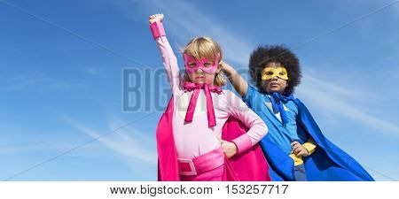 Two kids wearing superhero with sky background
