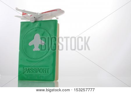 passport with toy airplane on the white background