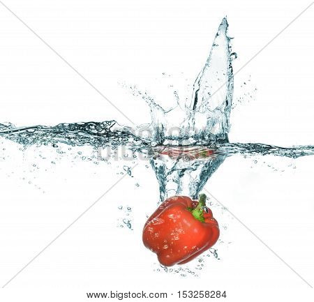Sweet Red Pepper In Water With Splash. Isolated