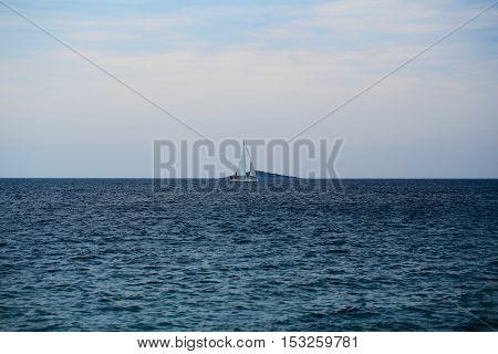 Sailboat In Blue Sea