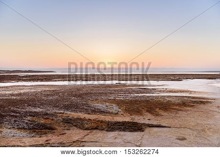 Cristal salt formation on the coast of Deas Sea Jordan at sunset.