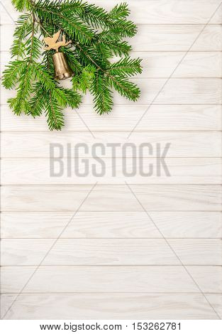 Christmas tree branches on bright wooden background. Undecorated evergreen twigs