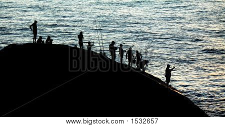 Anglers At Sunset