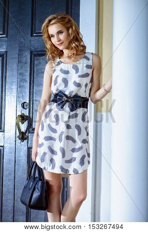 Happy young woman walking in the city on a sunny summer day. Fashion shot outdoor.