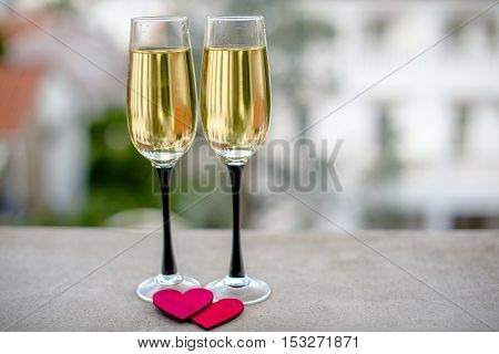 two glasses of champagne and red hearts
