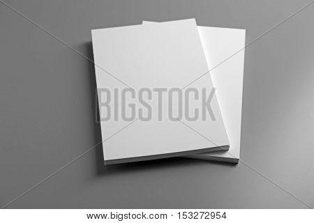 Blank notebooks on grey background