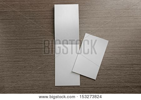 Blank notebooks on wooden background