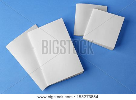 Blank brochures on blue background