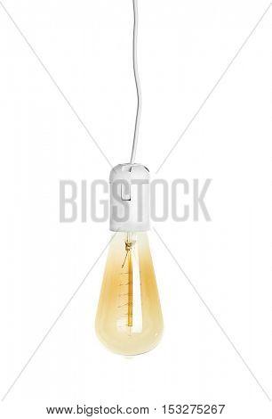 Light bulb on light background