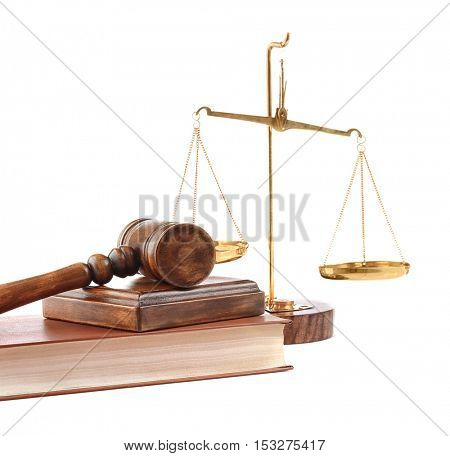 Gavel with book and scales isolated on white