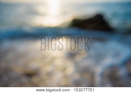 Blurred defocused background with the sea waves and sunny light leaks, summer vacation relaxing concept