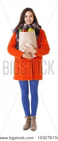 Young woman with shopping bag isolated on white