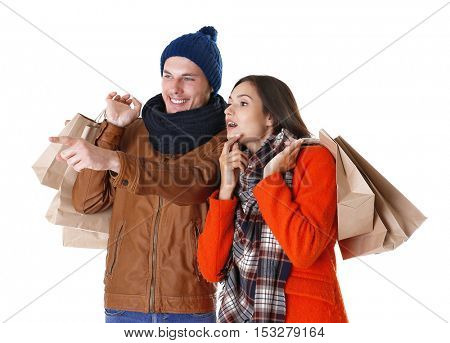 Happy couple with purchases isolated on white
