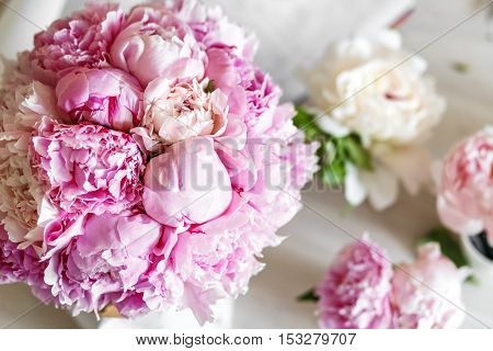 Pink peonies in workshop place before making bouquet