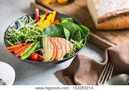Apple with Spinach Sprout and Pepper salad by bread loaf
