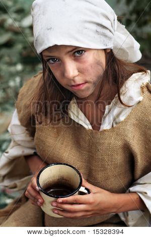 Poor little beggar girl with a vintage mug in her hand. Please check for more.