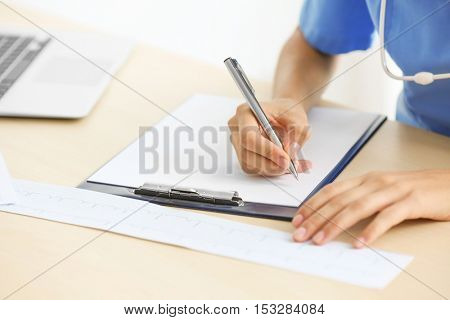 Doctor writing prescription, close up