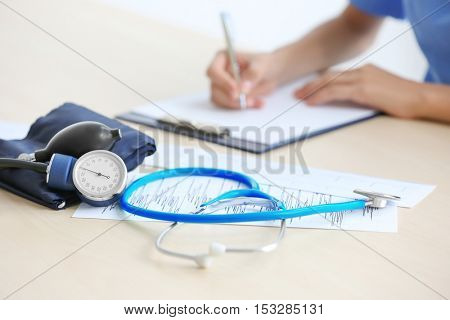 Stethoscope and blood pressure meter on doctor's table