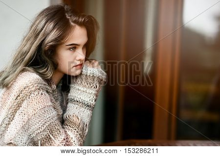 Woman Relaxing On Home Terrace