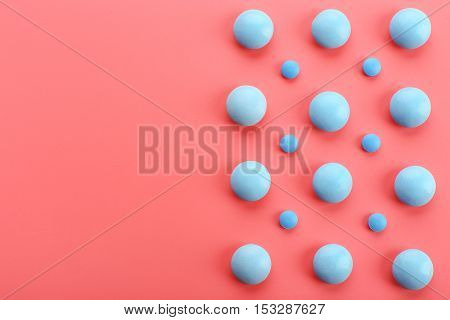 Color pills on pink background