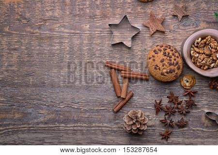 Composition of cookie and natural decor on wooden background