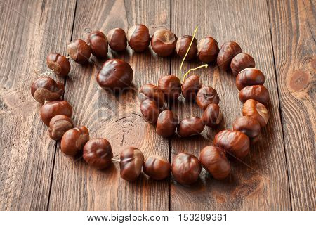 Jewelry made from chestnuts as crafts for kids