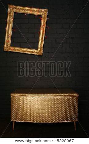 Gallery display - ornate frame, chest and kitch lights