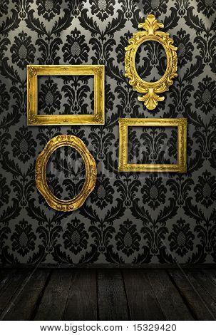 Marcos de oro, papel pintado retro, focos desde arriba