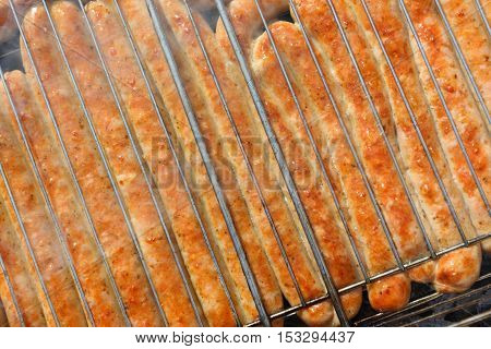 sausages roast on the barbecue grate in clear day
