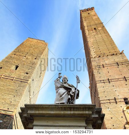 Statue of Petronius and two ancient towers in Bologna, Italy