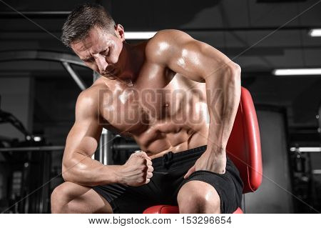Handsome Athletic Fitness Man Posing And Trains In The Gym.