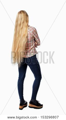 back view of standing young beautiful  woman.  girl  watching. Rear view people collection.  backside view of person.  Girl with very long hair standing thoughtfully.