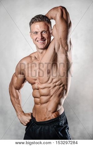 Strong Athletic Man Fitness Model Showing Six Pack Abs