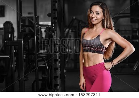 Beautiful Fitness Woman Trains In The Gym.