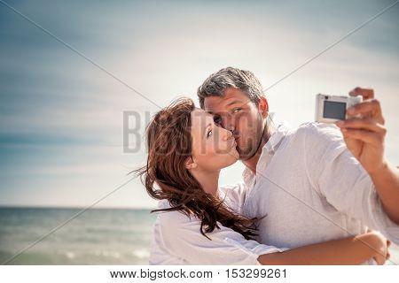 romantic beloved couple taking selfie
