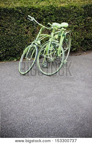 Two old bikes entirely varnished in green