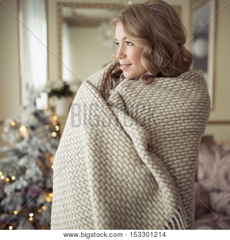 Beautiful Pregnant Woman In Comfy Clothes. Christmas Tree On Background.