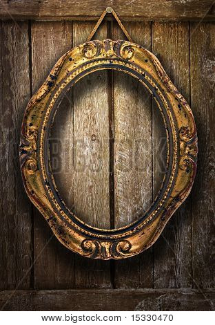 Gold frame on a wooden background