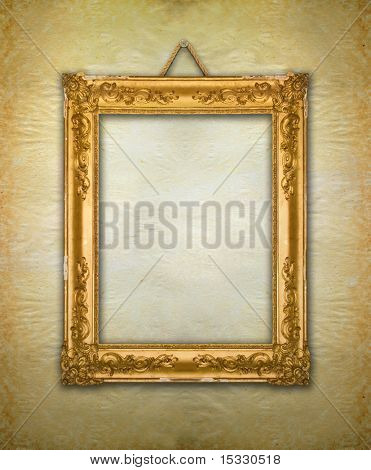 Gold frame, aged wallpaper