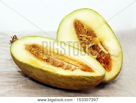 two halves of fresh sweet melon on white background
