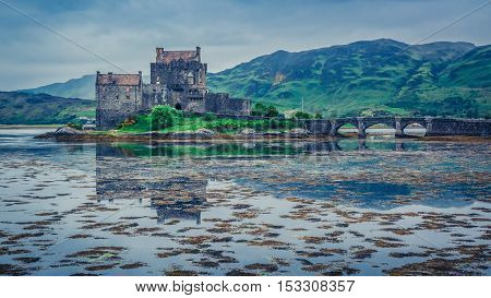 Sunset Over Lake At Eilean Donan Castle, Scotland