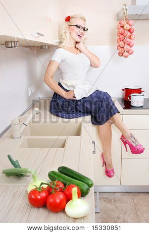 Cheerful housewife in the kitchen, similar available in my portfolio