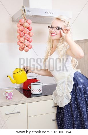 Cheerful housewife pouring tea, similar available in my portfolio